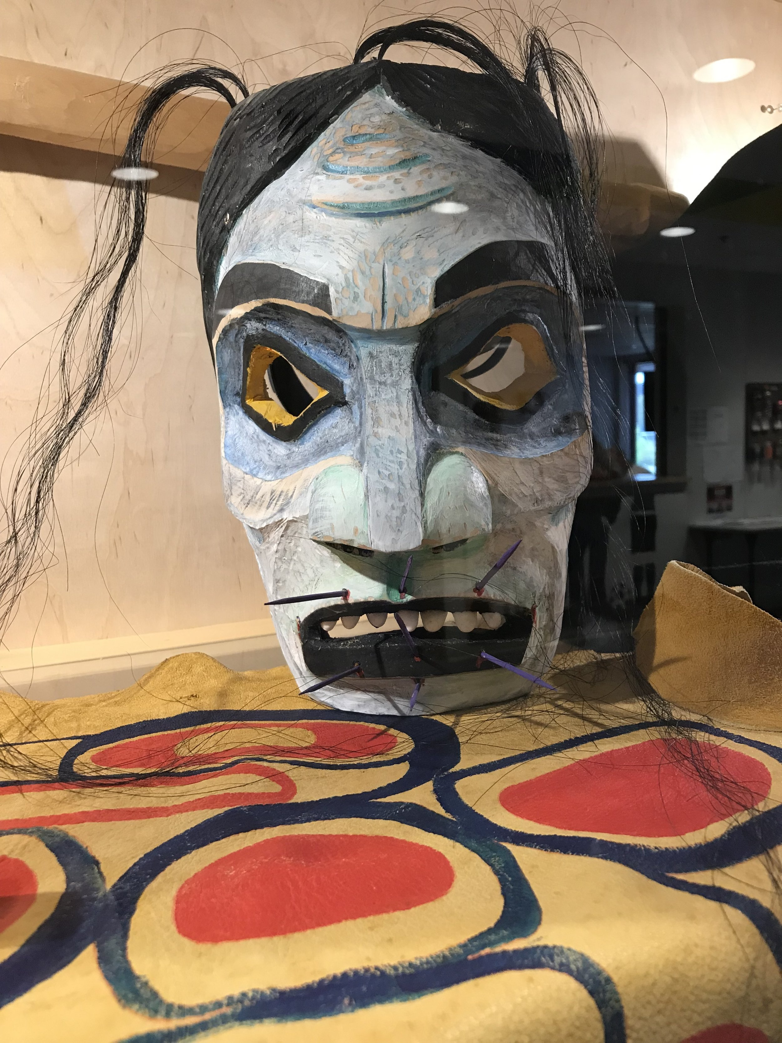 Mask of the  Gaagiixiid , the wildman - the character in the   SG̲aawaay Ḵʹuuna:   Edge of the Knife