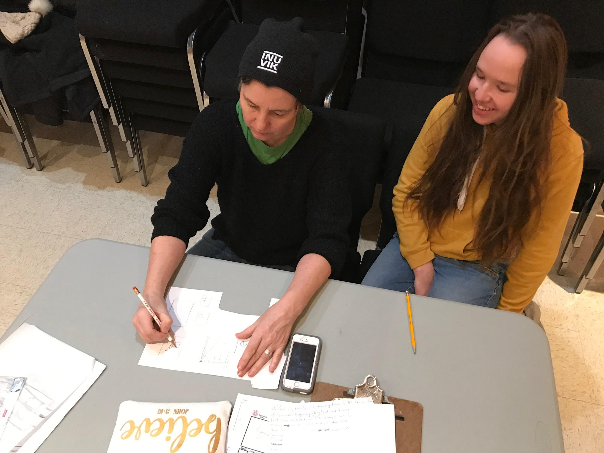 Cheryl (left) draws using perspective with Esther in Fort McPherson