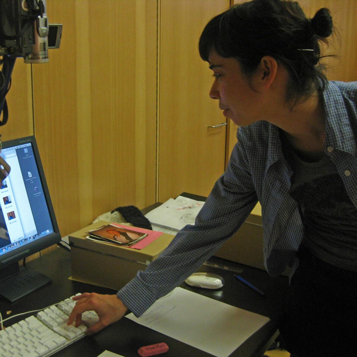 Catrina Longmuir checks photo image resolution in Bella Coola BC