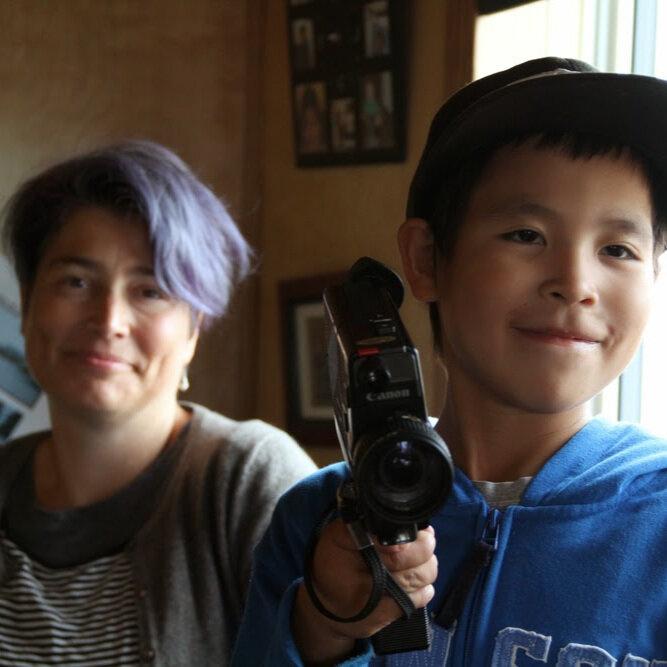 Lisa (left) helps Desmond film using a super 8 camera in Old Crow