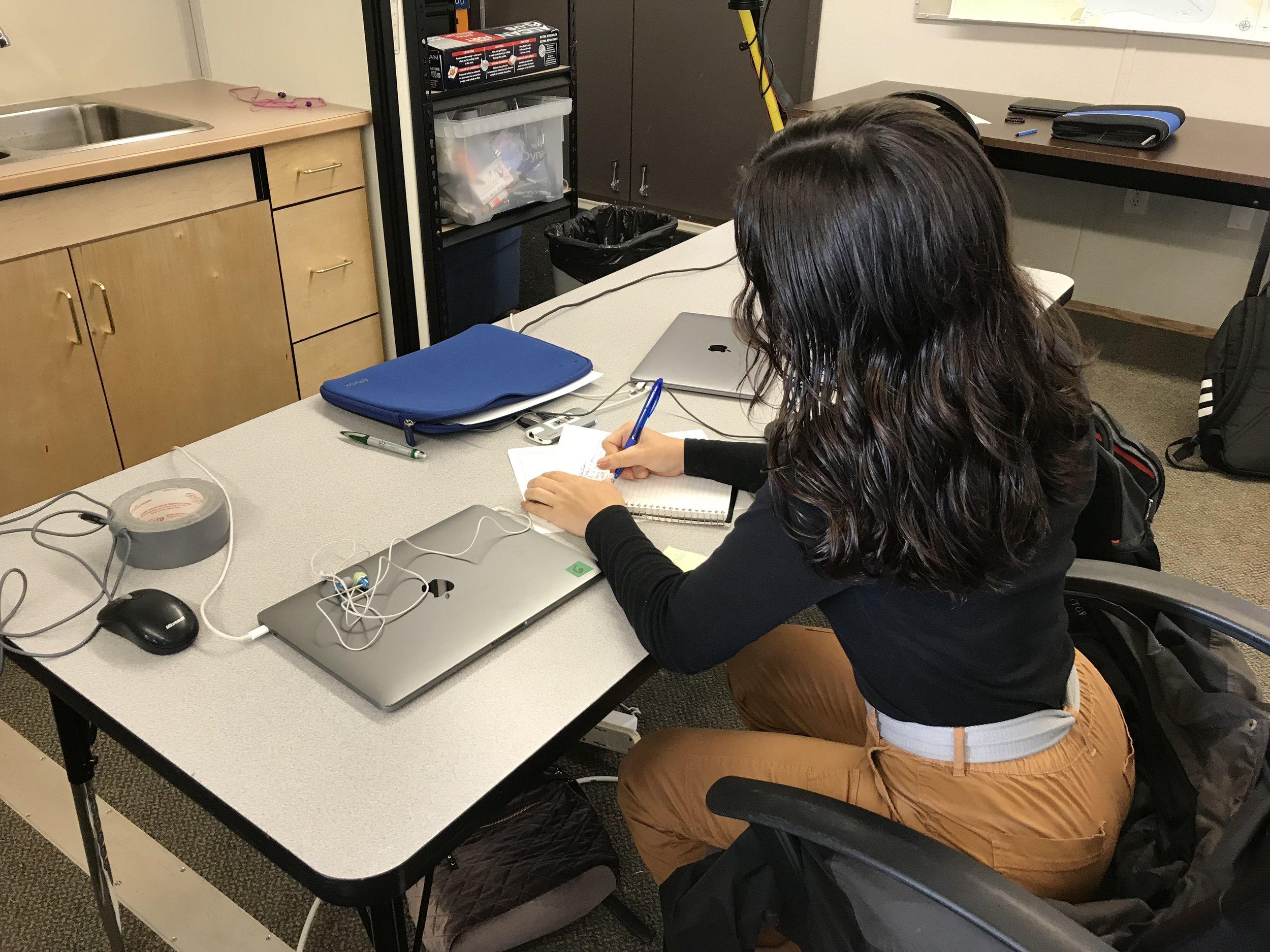 Shekinah works on her story notes