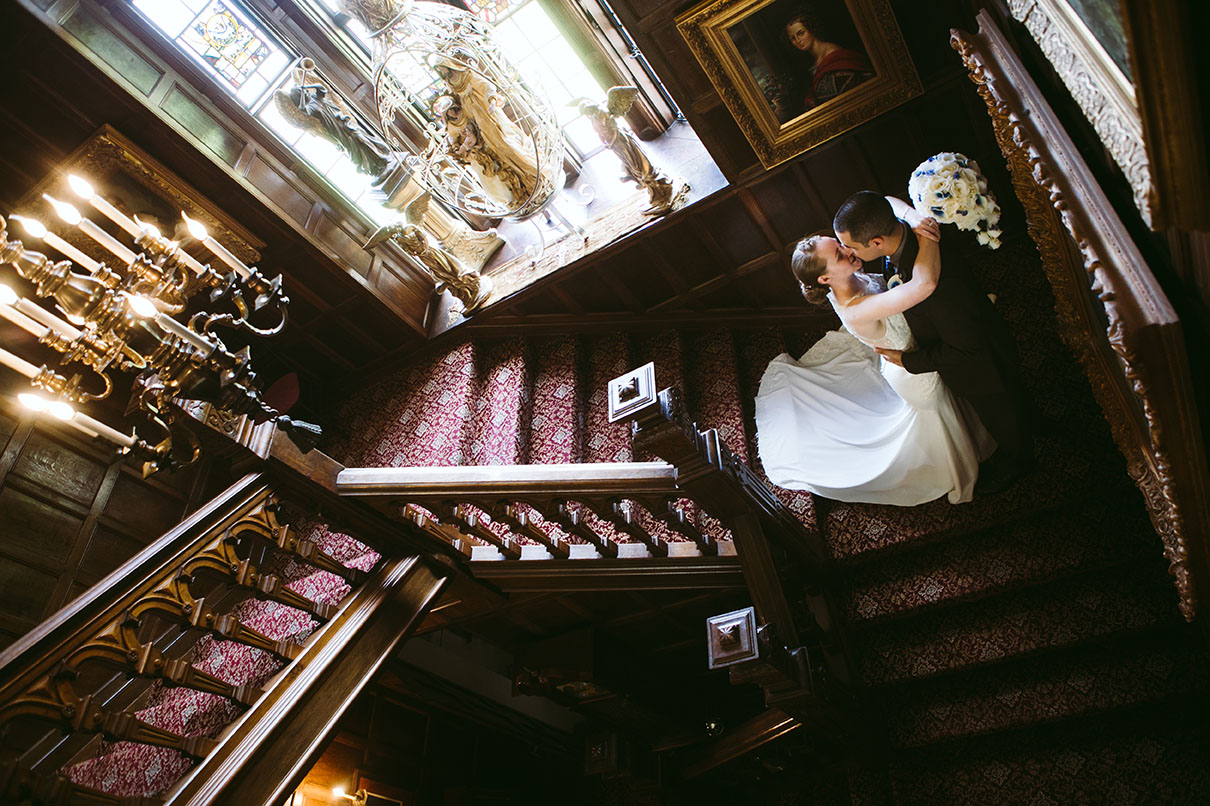 Seattle Wedding Thornewood Castle Bride and Groom on Staircase