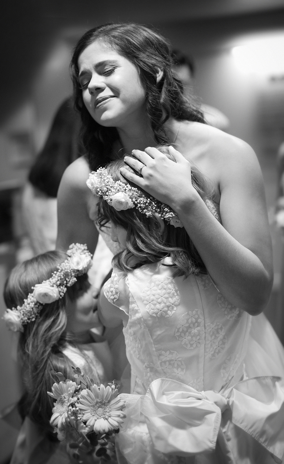 Bride and Flowergirls Hug Black and white