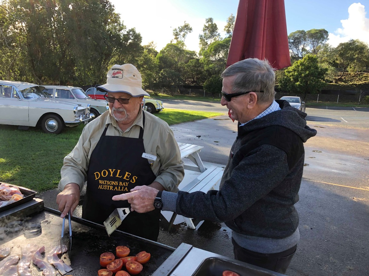 Ken taking a few tips on how to run a BBQ from Brian Wright