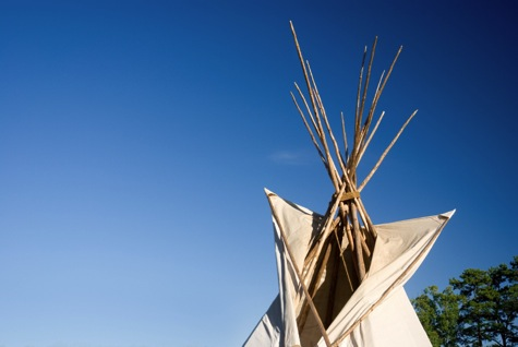 Tipi top off to right with blue sky .jpg