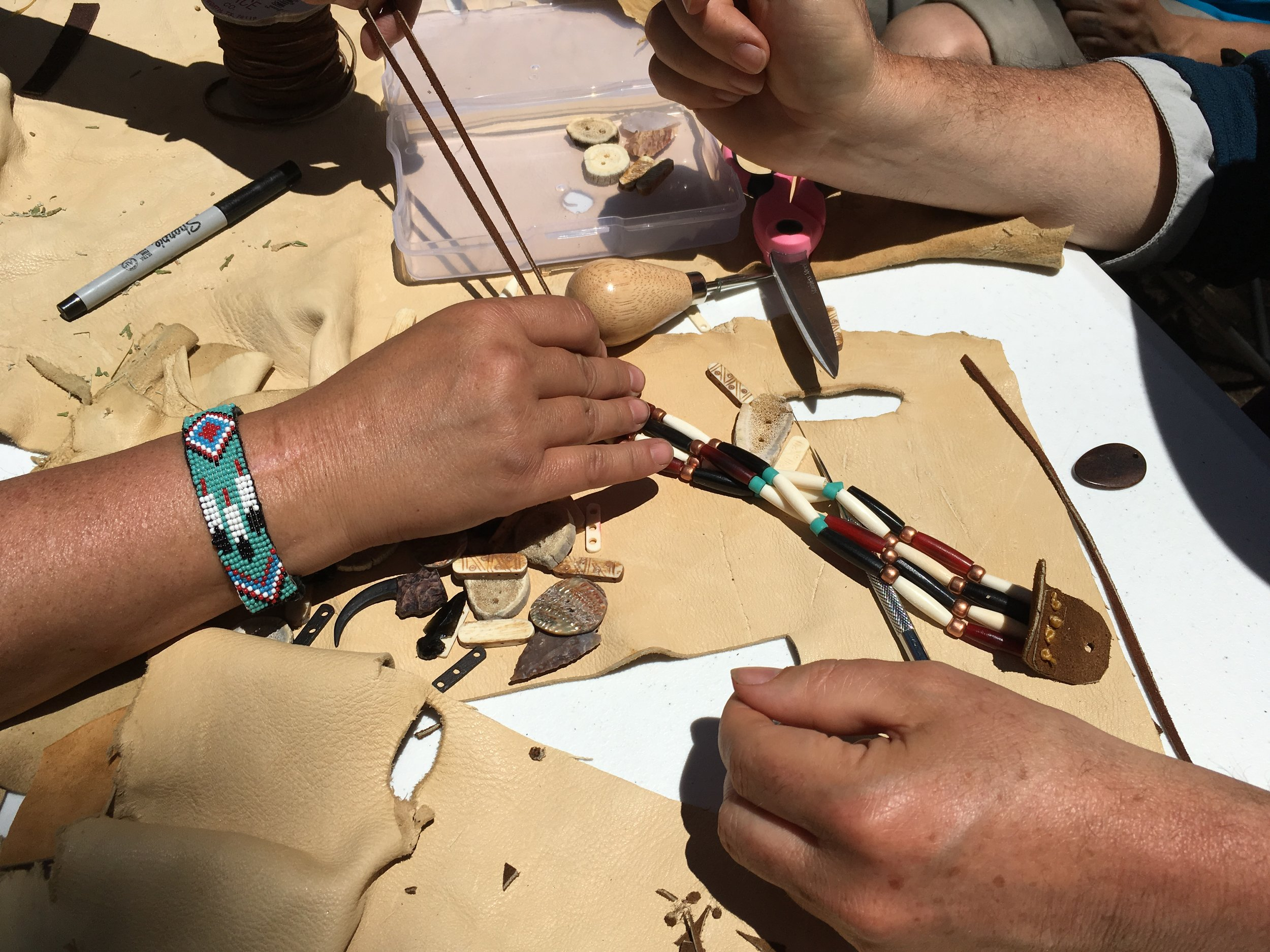 Activities may include: smudging, spear/atlatal throwing,reflective nature walks, traditional ways of food preparation, Native American games, quill work, traditional choker making, story telling, daily nature connection activity, and using earth paints.