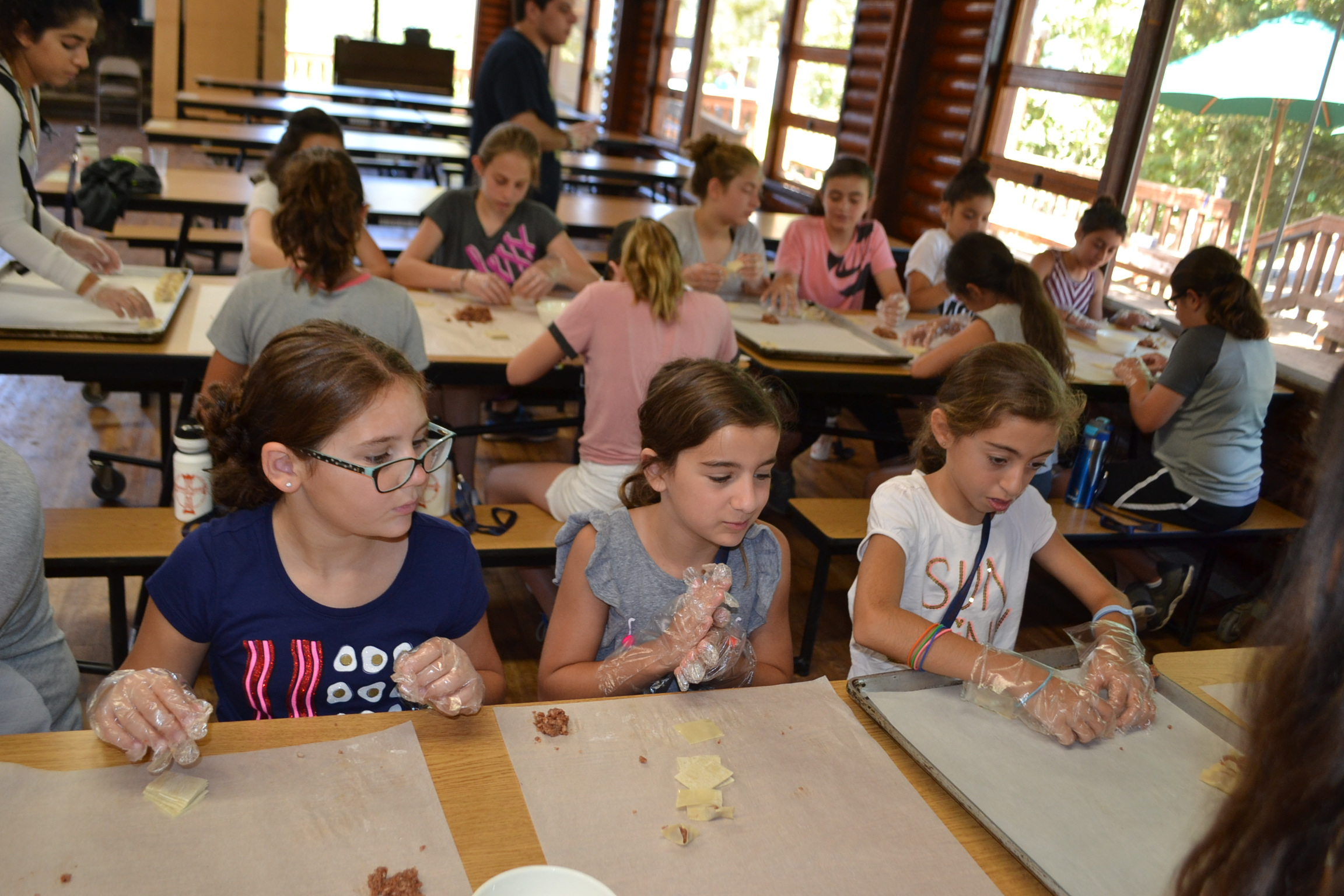 Campers learning how to make mante!
