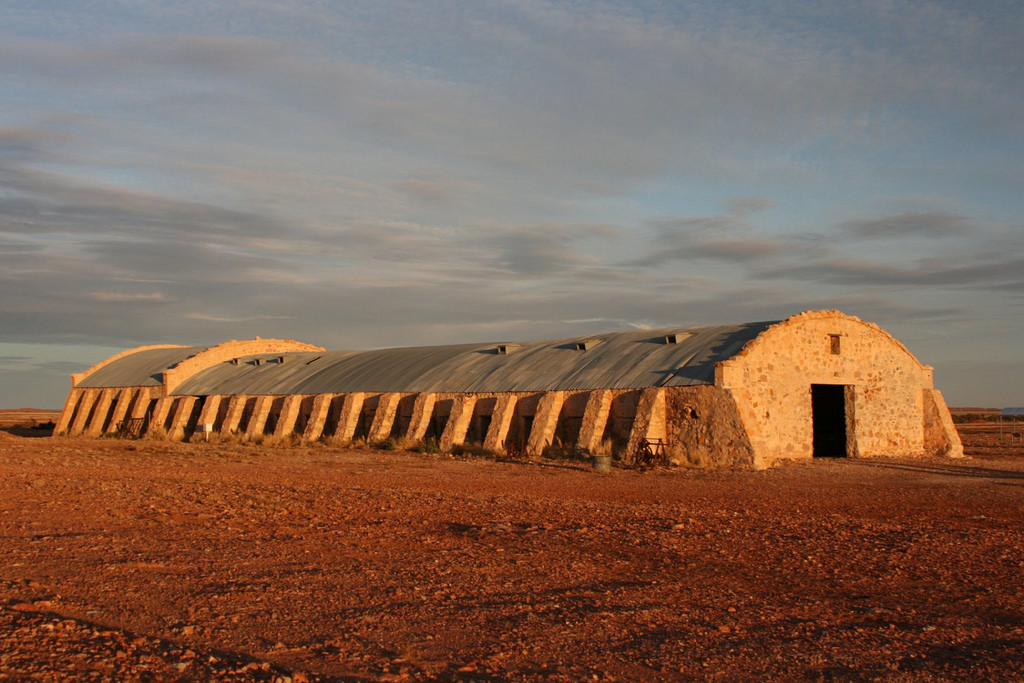 The majestic Cordillo Downs shearing shed. Note, lack of timber is overcome by bending steel two ways! Look familar?