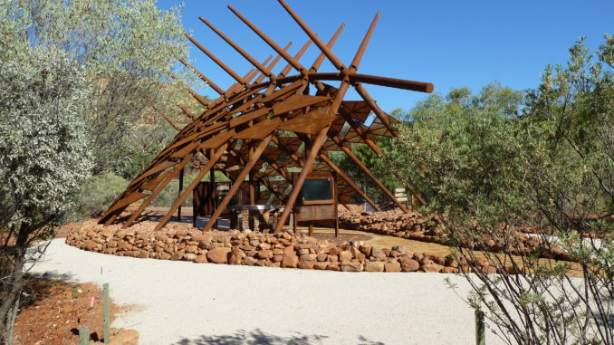 """Information shelter at Kings Canyon National Park – a collaborative creation by Tangentyere Design and the traditional owners of Watarrka (Kings Canyon). The shelter's design is based on a  Tjilkamata  (echidna) story - """"a children's story about food""""."""