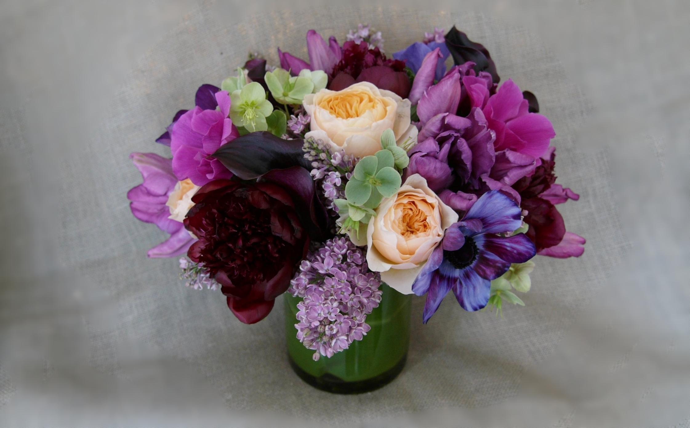 spring flowers in deep jewel tones with burgundy peonies liliacs garden roses.jpg