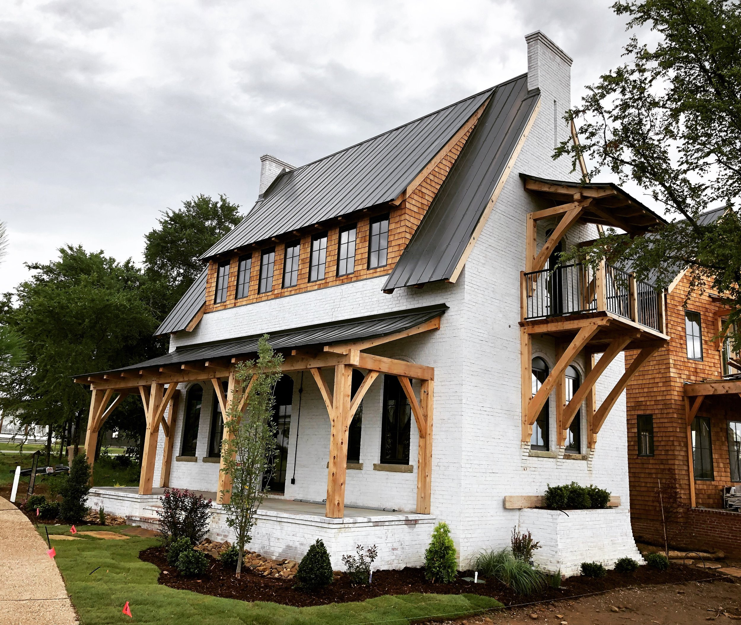 The Edison - a Solid Brick Masonry Home  with exposed whitewashed brick