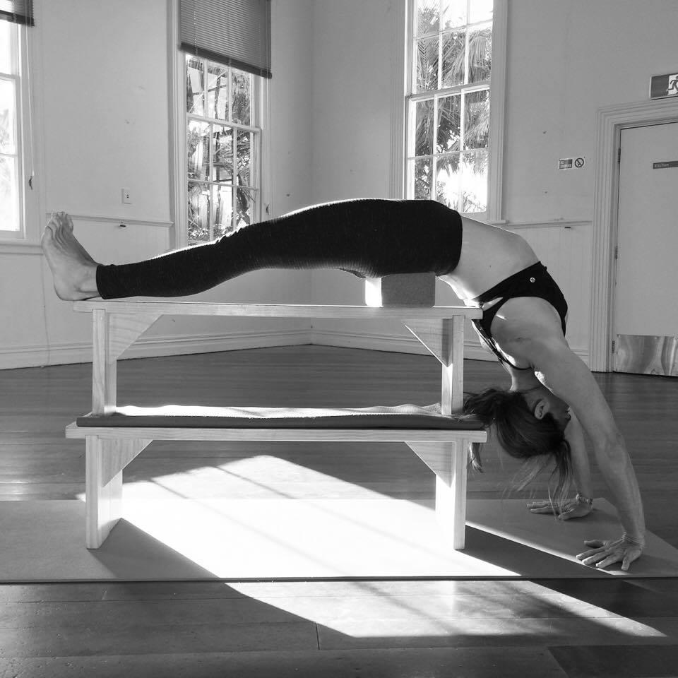 Suzi Carson in supported urdhva Dhanurasana at four Winds Yoga.