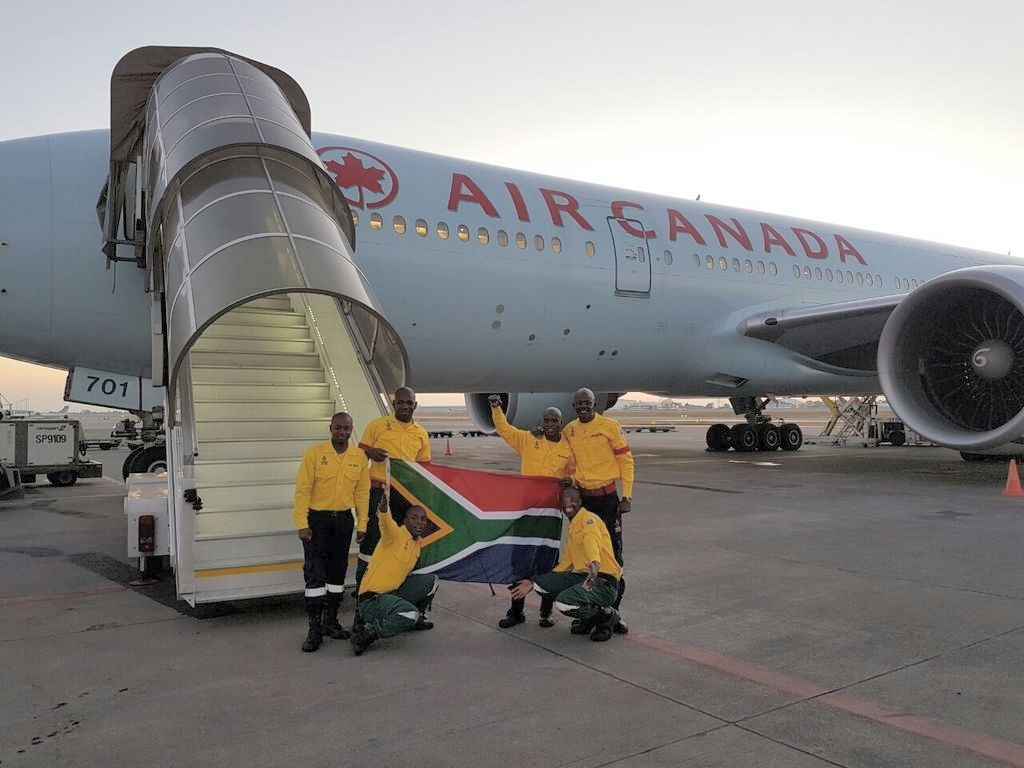 300 firefighters from South Africa arrive to assist Alberta.