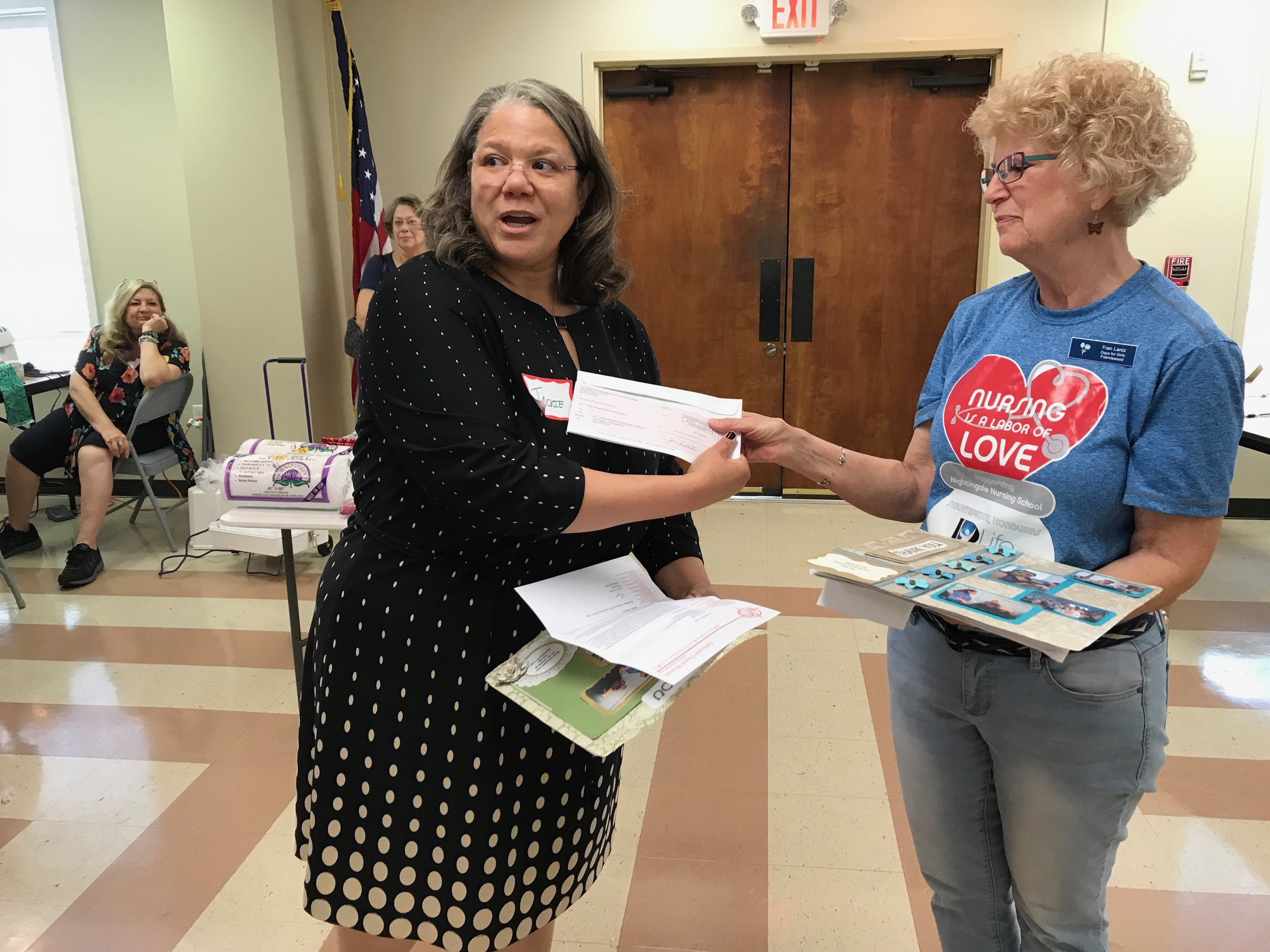 Jackie Meeks, Province VII Representative to the National ECW Board, presents the grant check to Fran Lantz, advocator for Days for Girls in the Diocese of Texas.