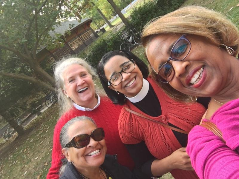 The Very Rev. Miguelina Howell, Dean of Christ Church Cathedral in Hartford, with Gloria Rogers, right, Province I Representative, Beblon Parks, Member at Large - Social Justice, left, and Mary Beth Welch, Province IV Representative, at Church Street Eats site in Bushnell Park