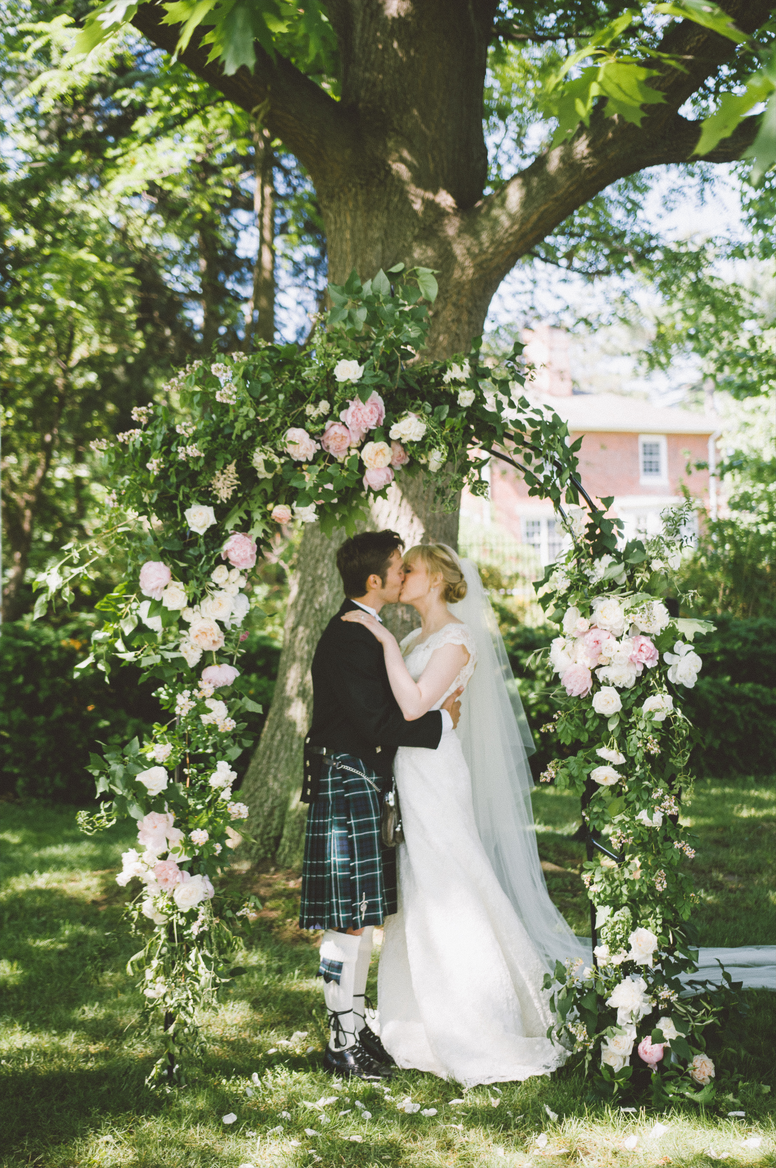 amanda cowley events niagara wedding planner kurtz orchard gracewood estate tree ceremony floral arch arbour first kiss