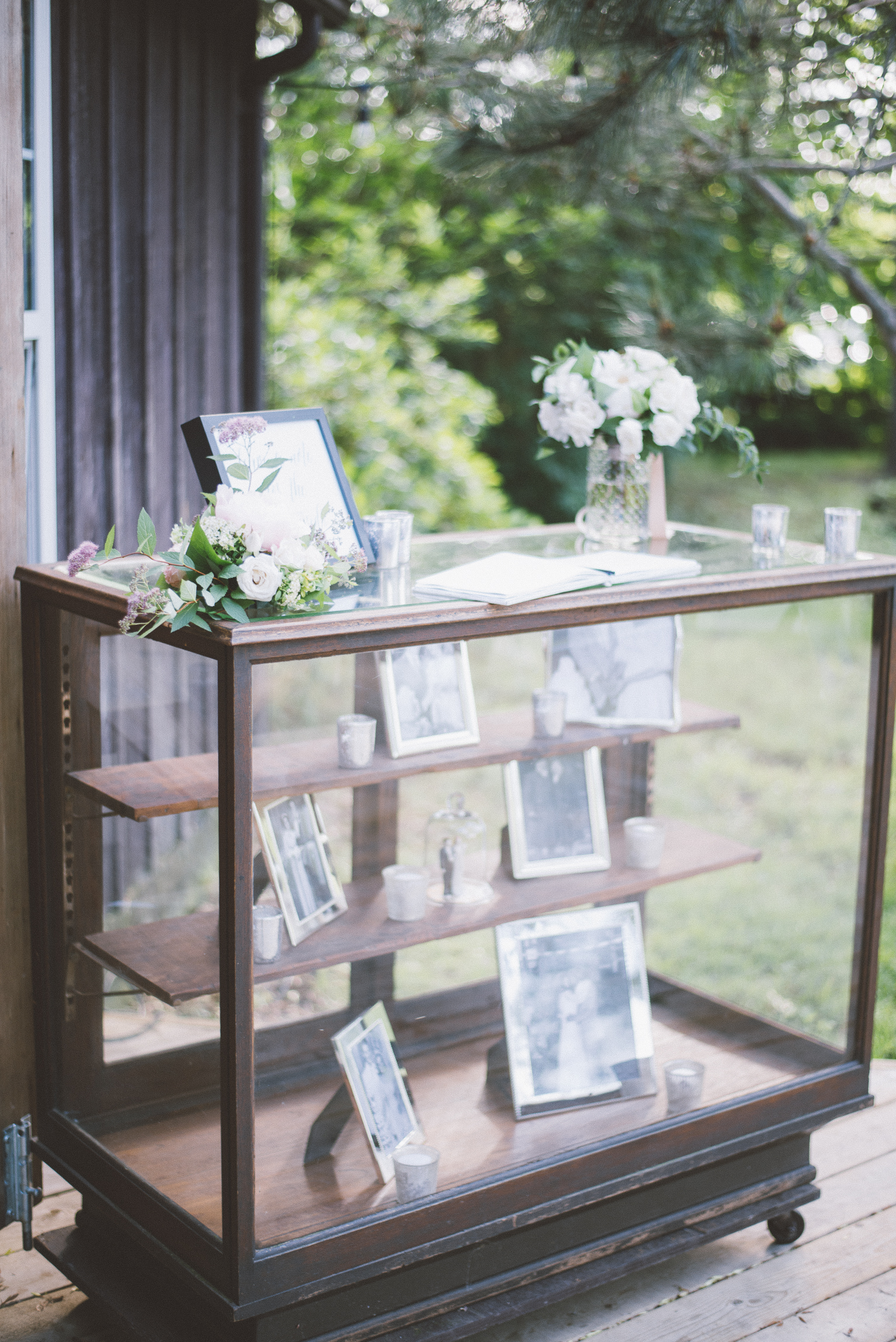 amanda cowley events niagara wedding planner kurtz orchard gracewood estate blush bridesmaids mix and match peony bouquets family photos memory frames apothecary chest display antique