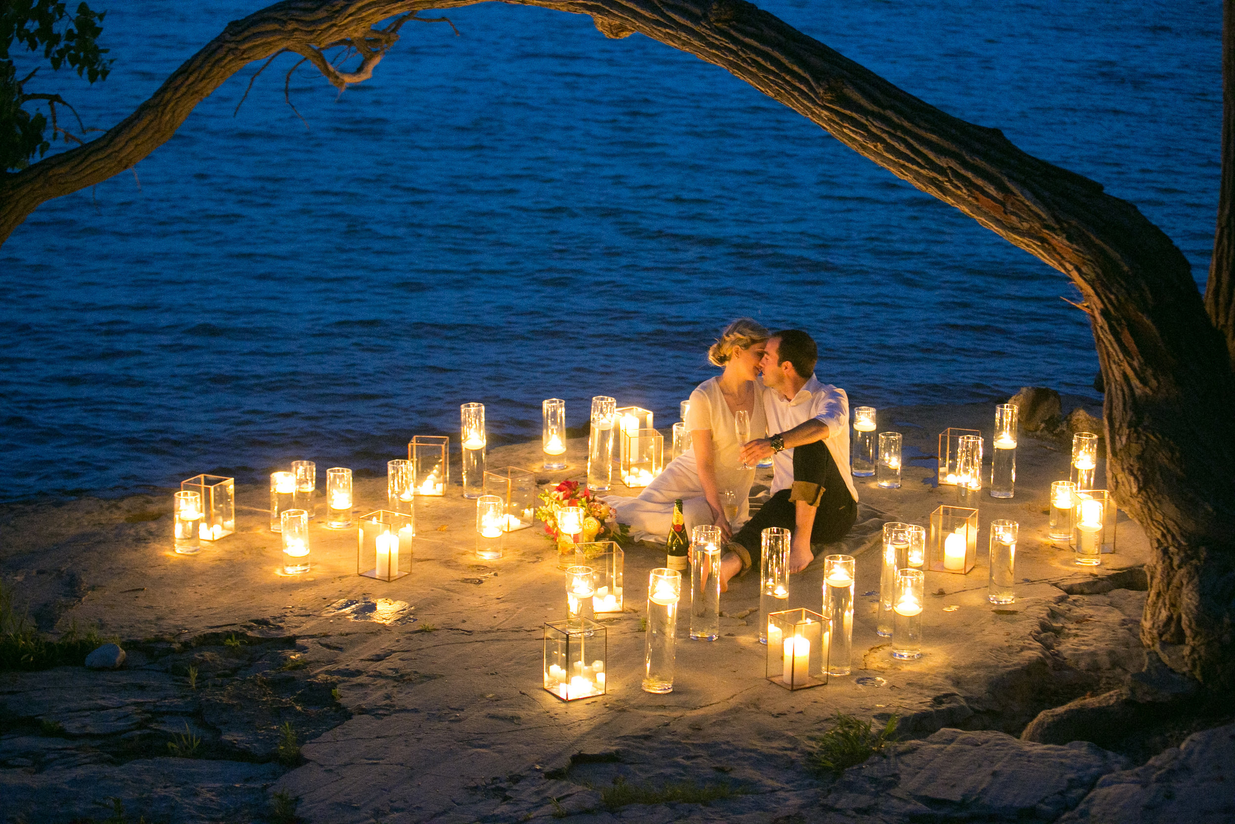 amanda cowley events niagara wedding planner beach engagement session sunset candlelight styled