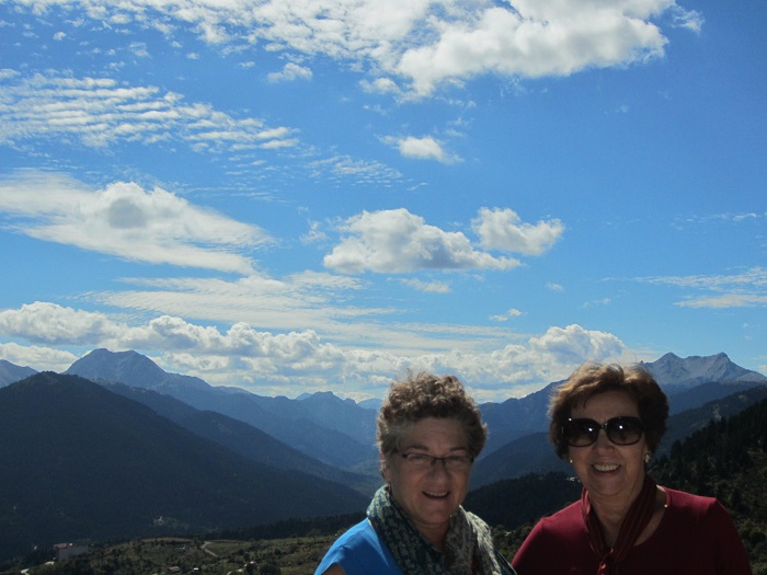 Mom (Helen)and her cousin Mary in front of the mountains of Karpenisi