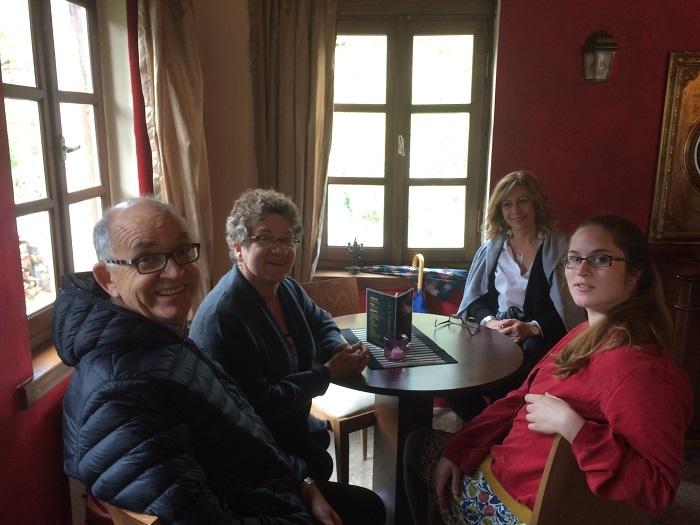 My greek family: round the table it's Nikos, my mom (Helen), Eftehia, and me (Katie)