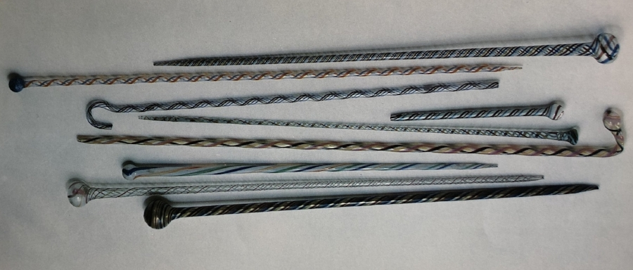 A selection of blown hollow glass candy stripe canes and batons