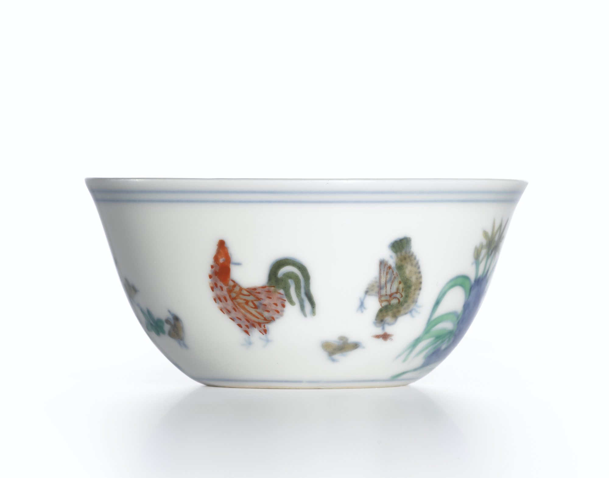 The Meiyintang 'Chicken Cup', the holy grail of Chinese porcelain. The designs were first drawn in cobalt blue on the unfired vessel. After glazing and high-temp firing, they were filled in with overglaze enamel pigments and then fired again at a lower temperature to bring out the vibrant colors.