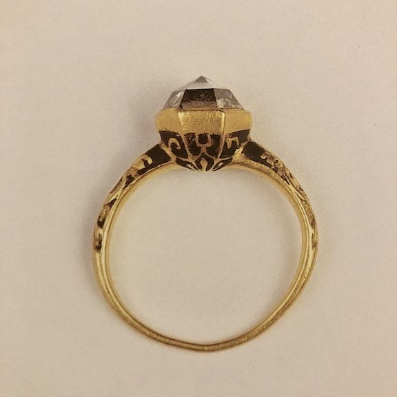 Gold ring set with a rose-cut diamond in a hexagonal bezel, c. 1610