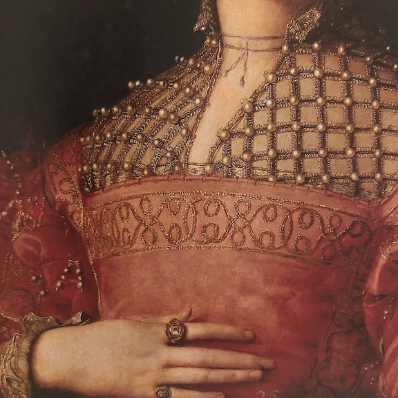 Portrait of Eleanora of Toledo c. 1543. Her hand at her breast is a gesture of fidelity. On her index finger is her wedding ring, a quatrefoil bezel set with a table cut diamond