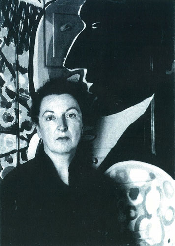 Pauline Kael in front of one of the house murals by Jess that will be unconvered, c. 1960