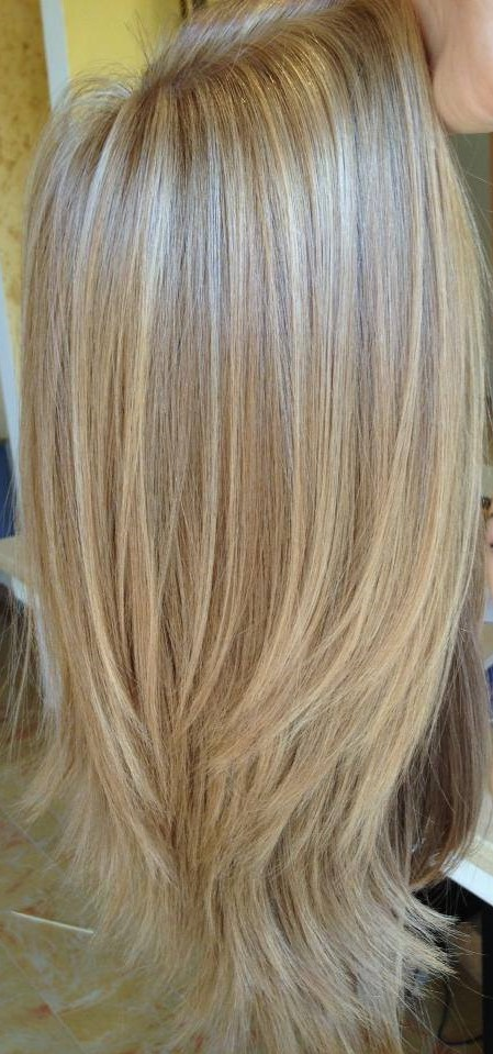 blonde wig holding.jpg