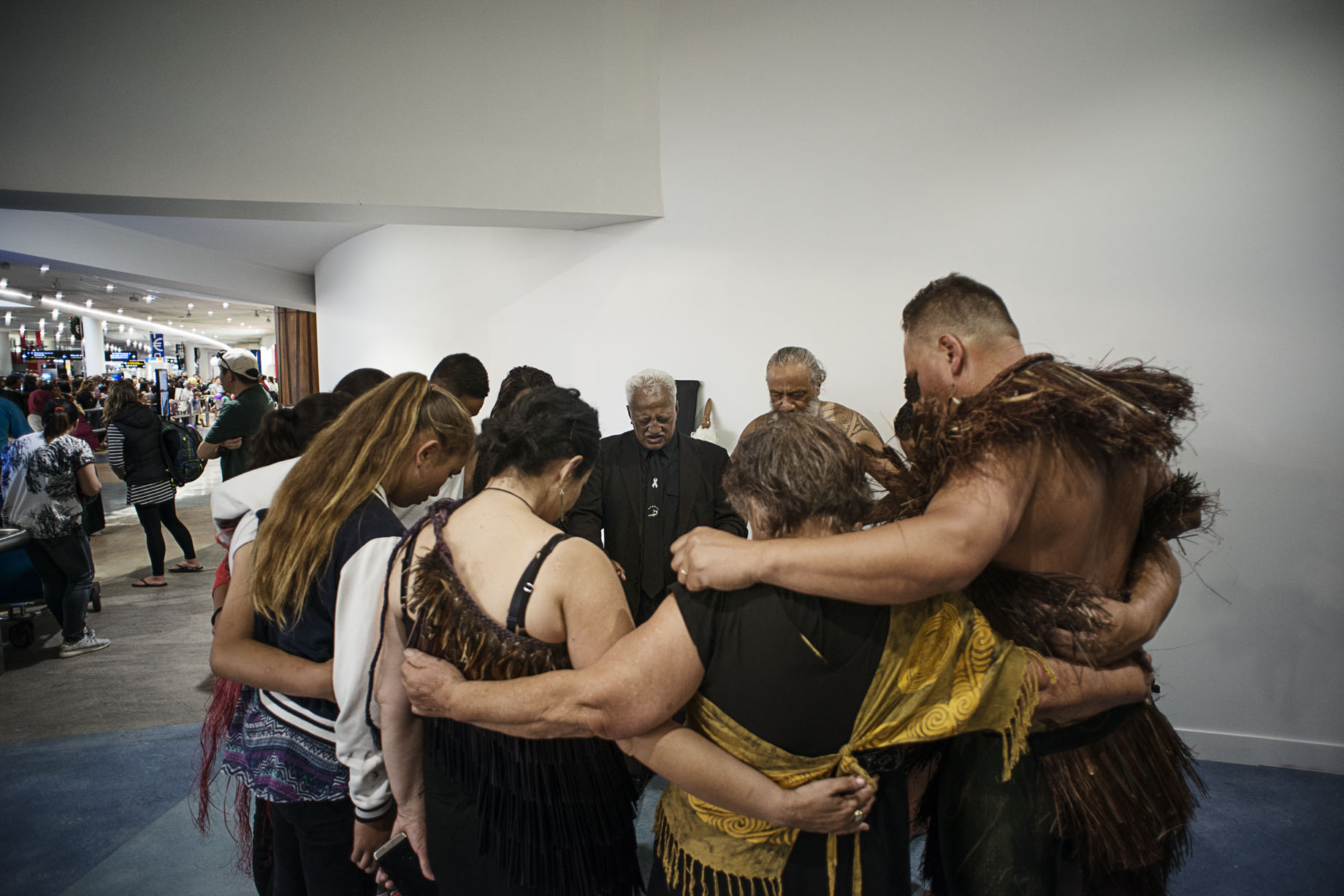 kaiHaka in prayer after the powhiri for Mya at Auckland Airport.