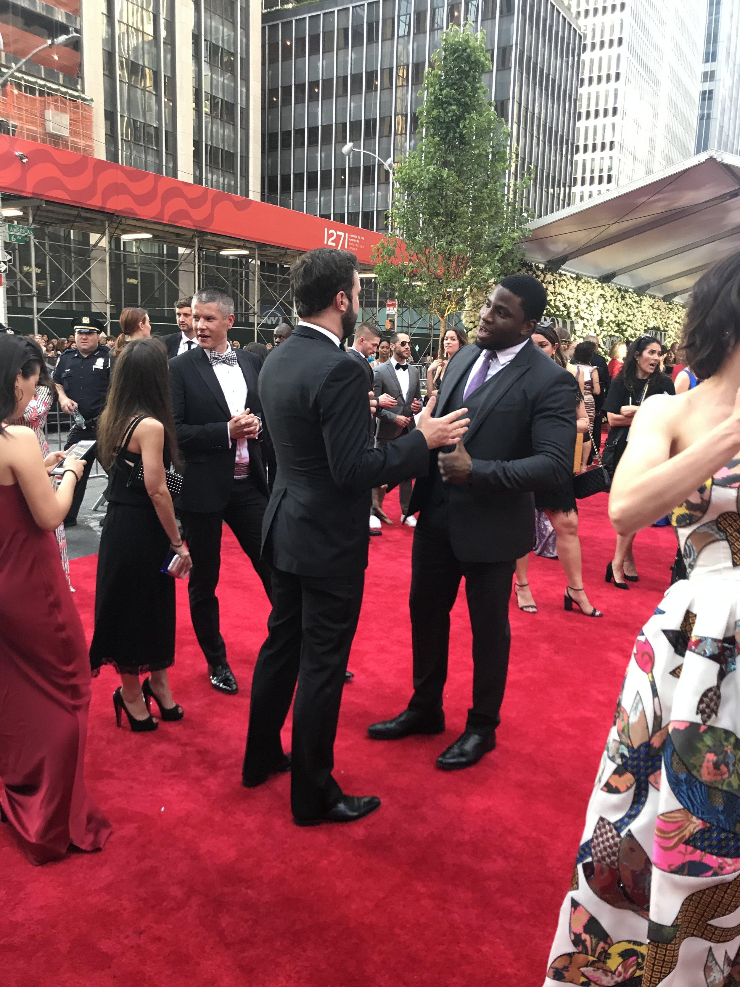 Hamilton  co-stars Okieriete Onaodowan and Taran Killam chat on the red carpet.
