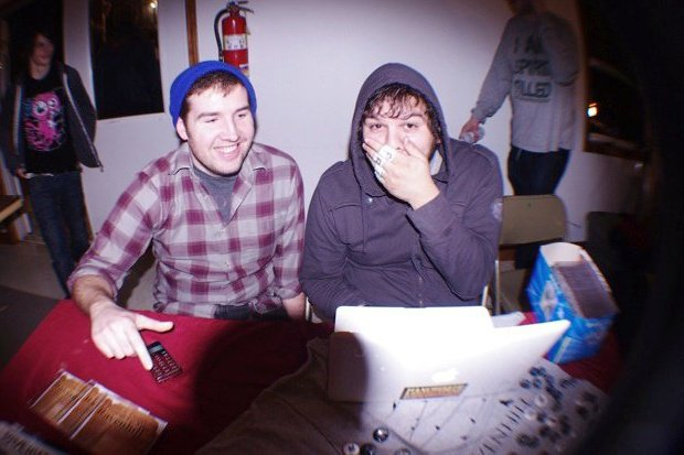 Josh and I at a show in Cape Girardeau, MO in 2010. Just look at that phone on the merch table we are so old.