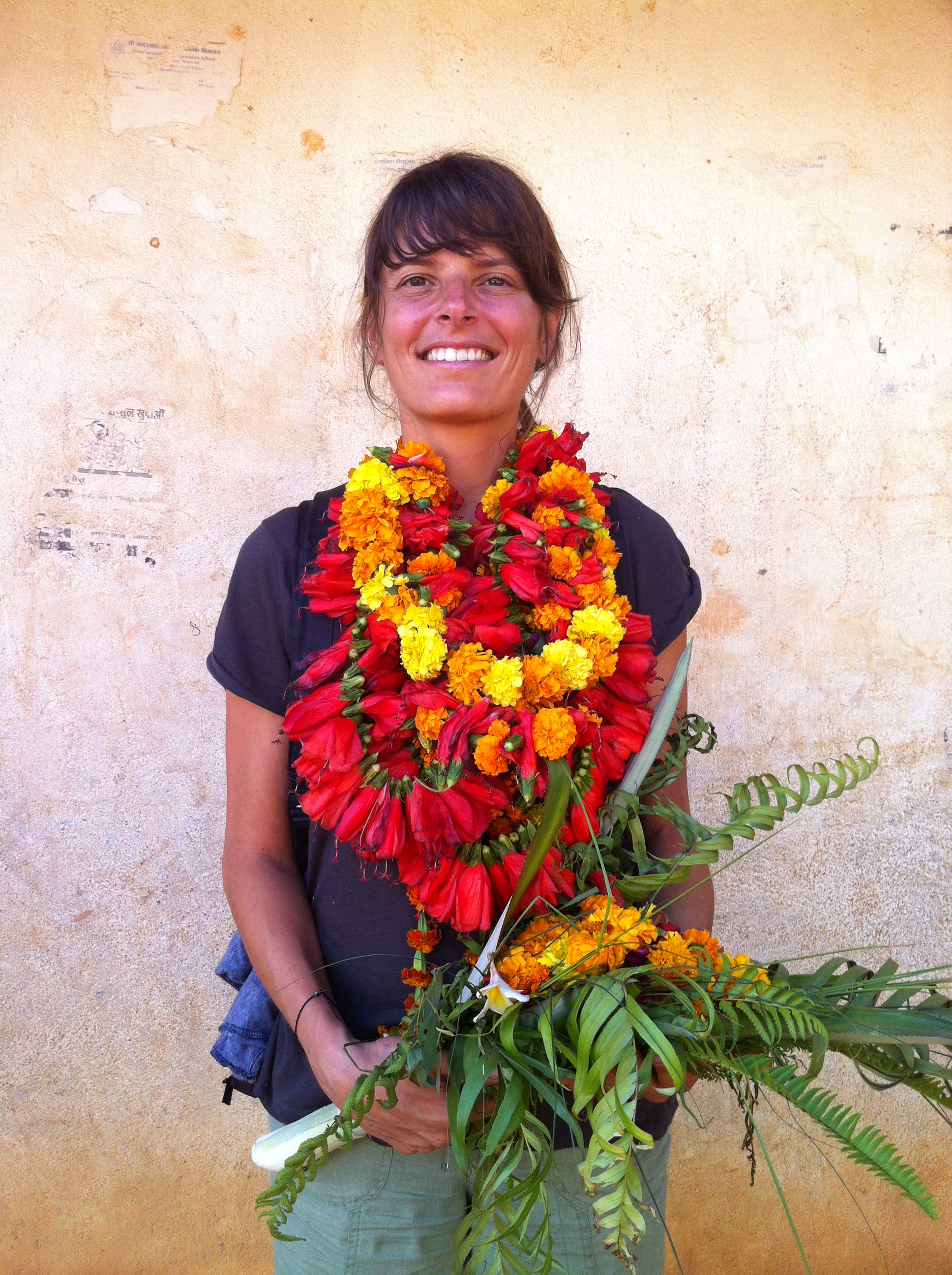 Perth Yoga teacher Samantha Britianco receives village flowers.JPG