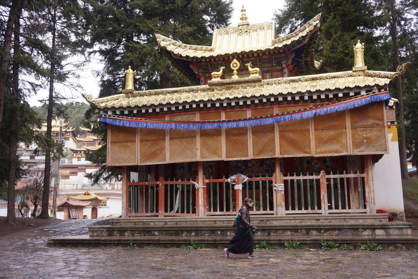 Becky walking around the closed Kirtri Monastery.