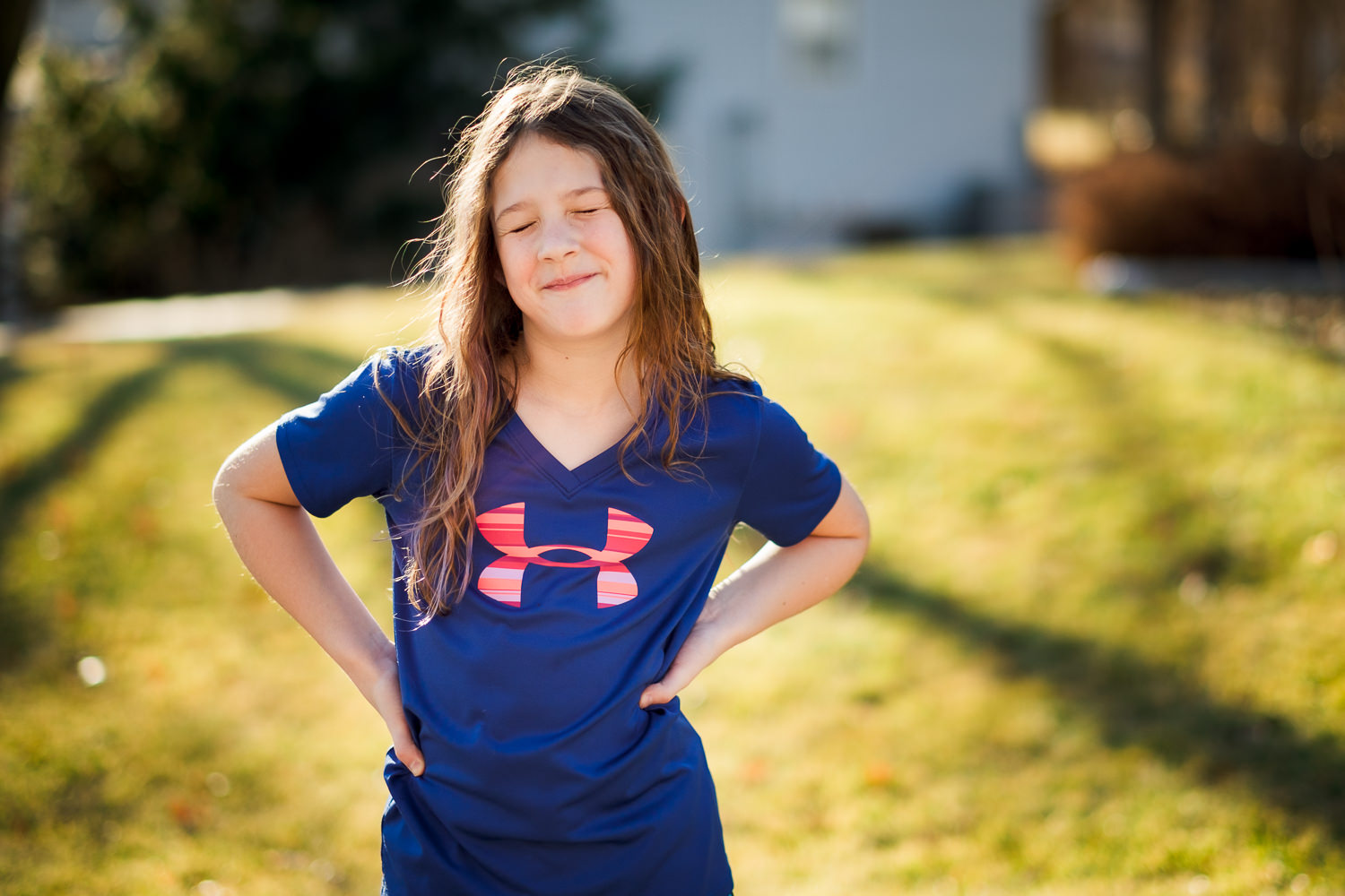 eight year old girl with long hair outdoors in Lincoln, Nebraska