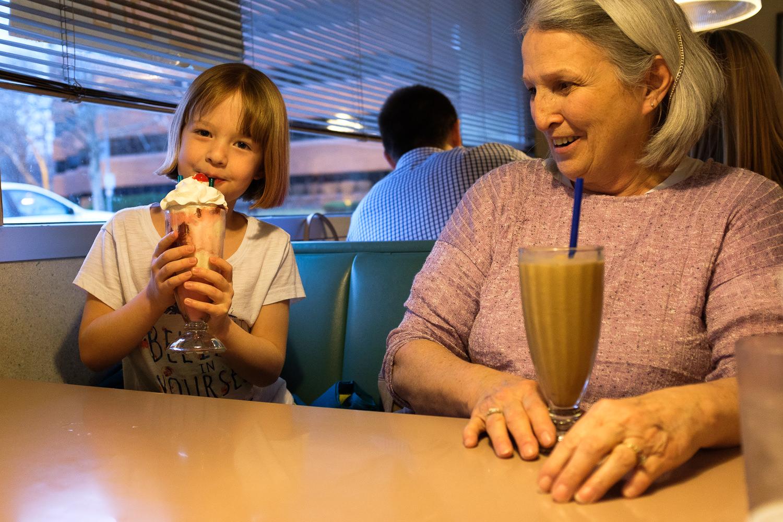 girl and woman drinking milkshakes