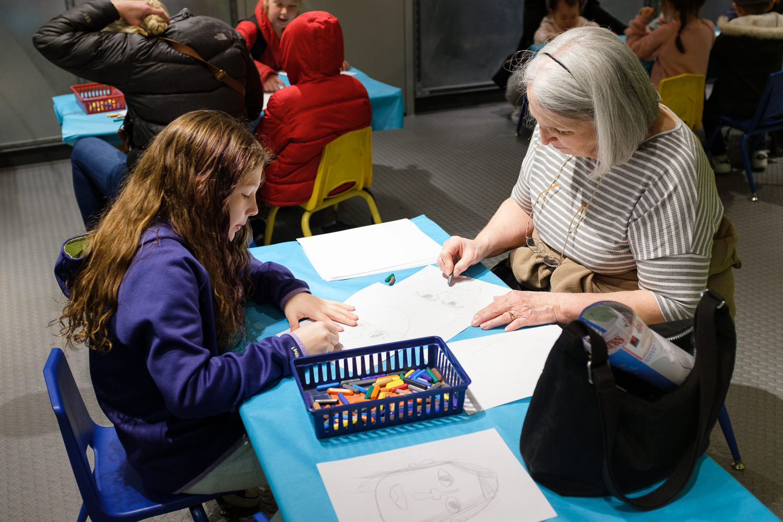 girl and grandma drawing portraits in Crayola Store Kansas City