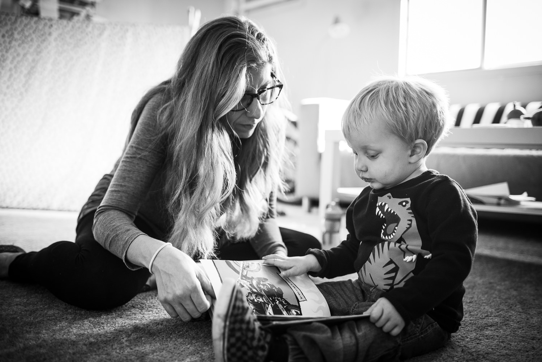 mom reading her little boy a book in Lincoln Nebraska.jpg