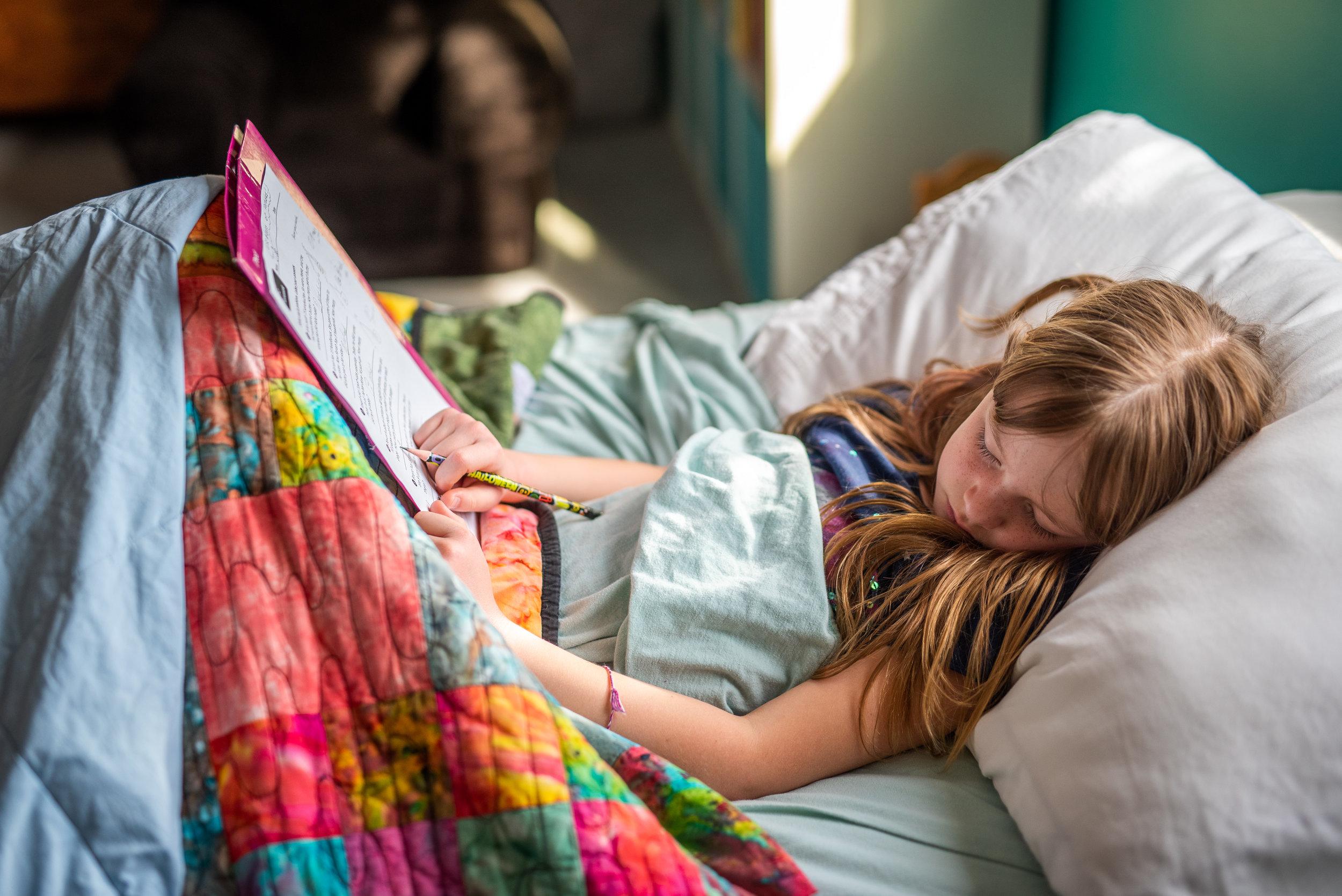 little girl fell asleep doing homework.jpg