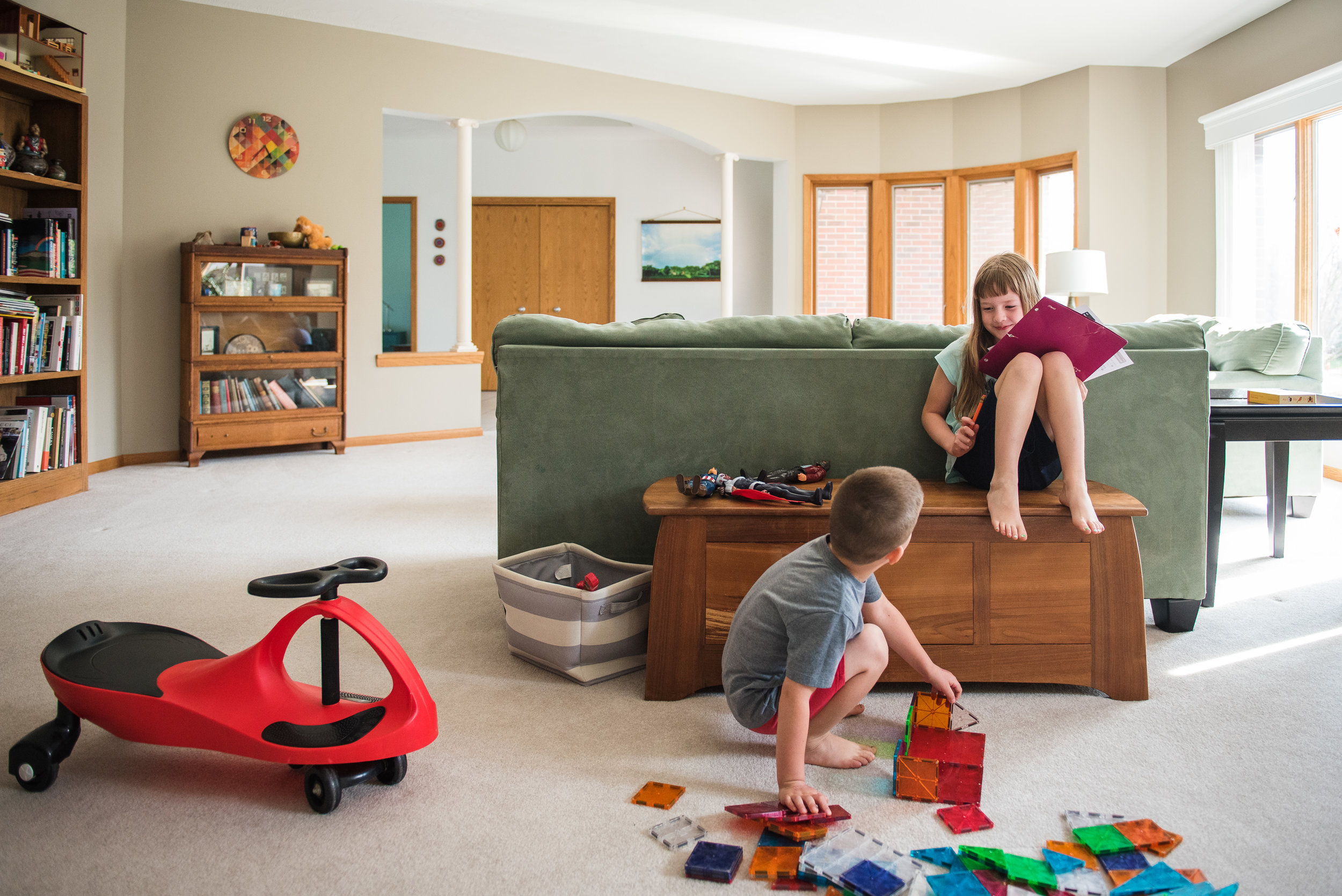 children playing in a living room with magnatiles.jpg