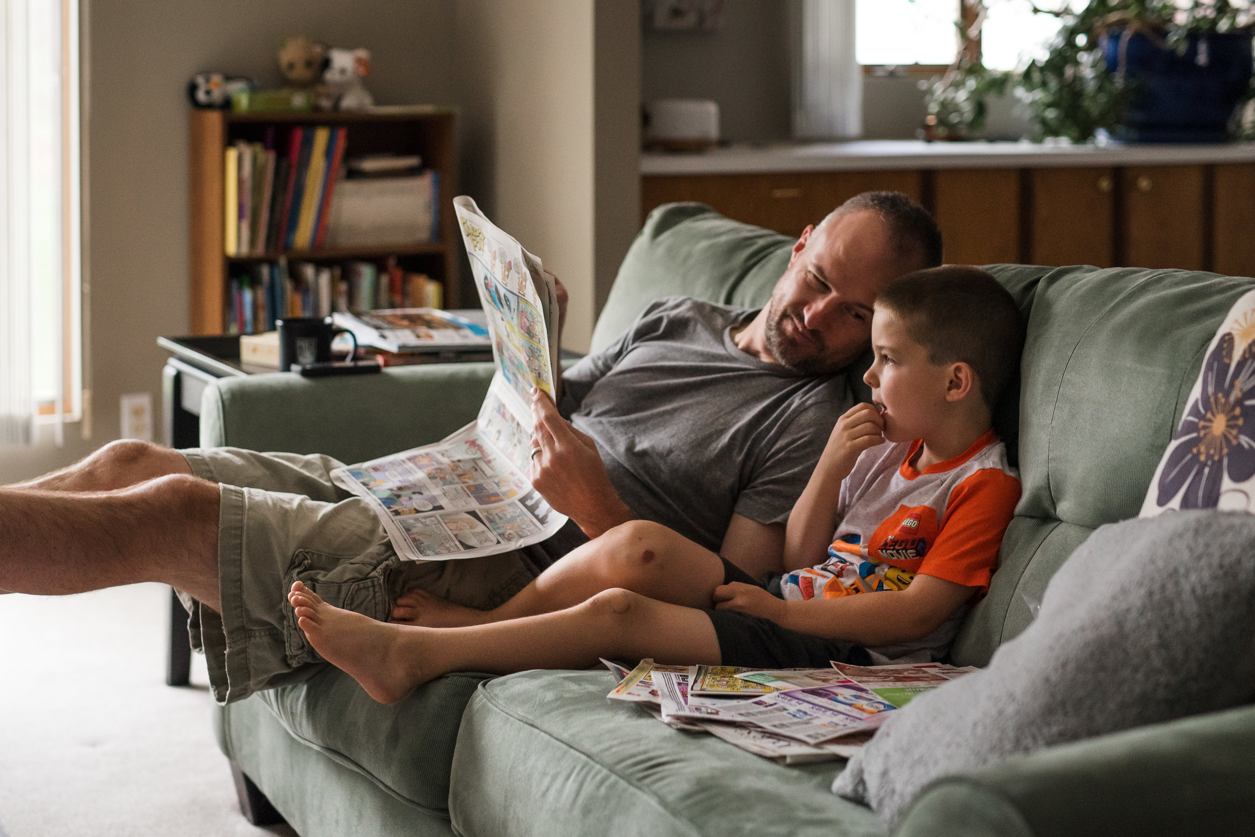 little boy and father reading the sunday newspaper together.jpg