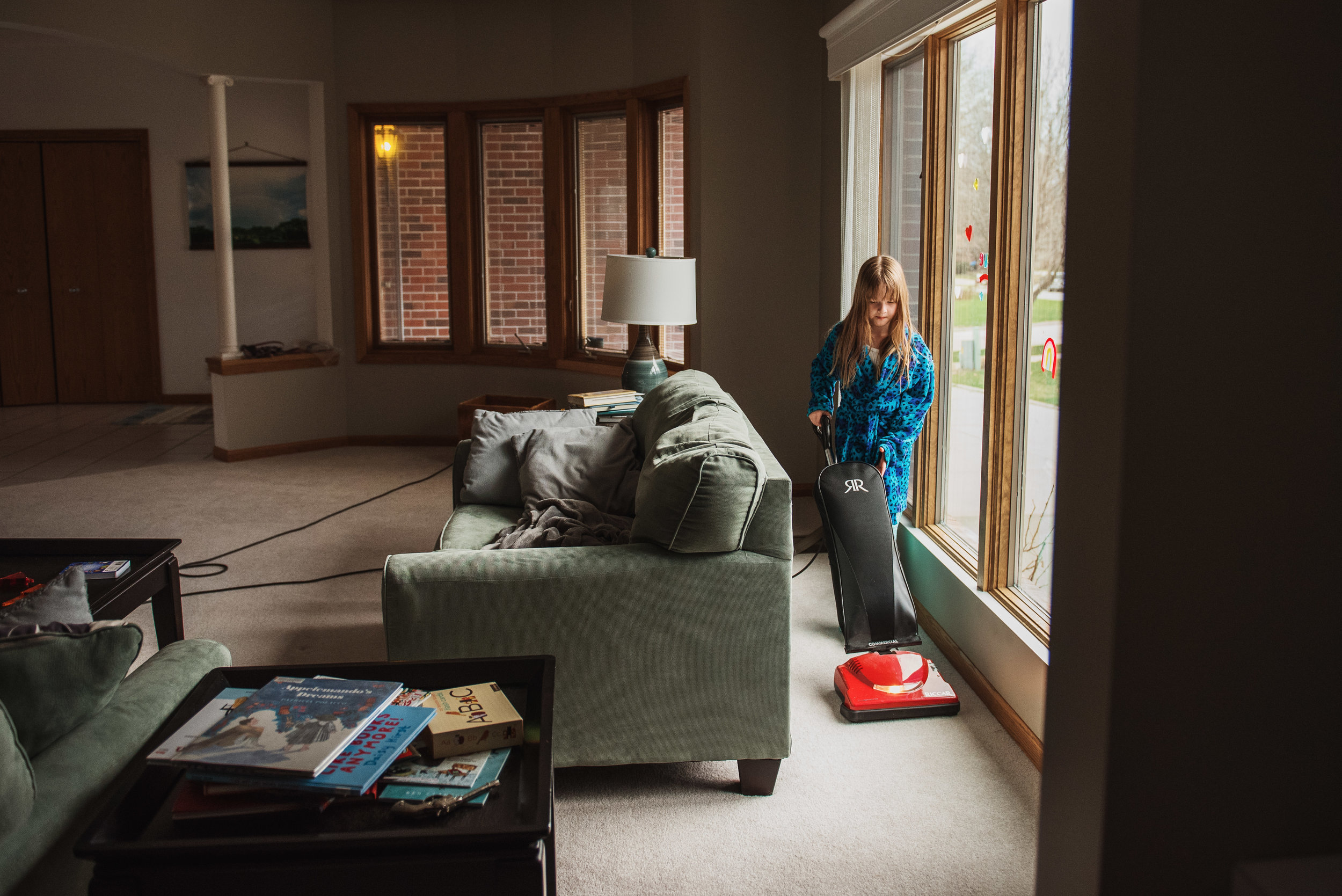 little girl vacuuming a living room_.jpg
