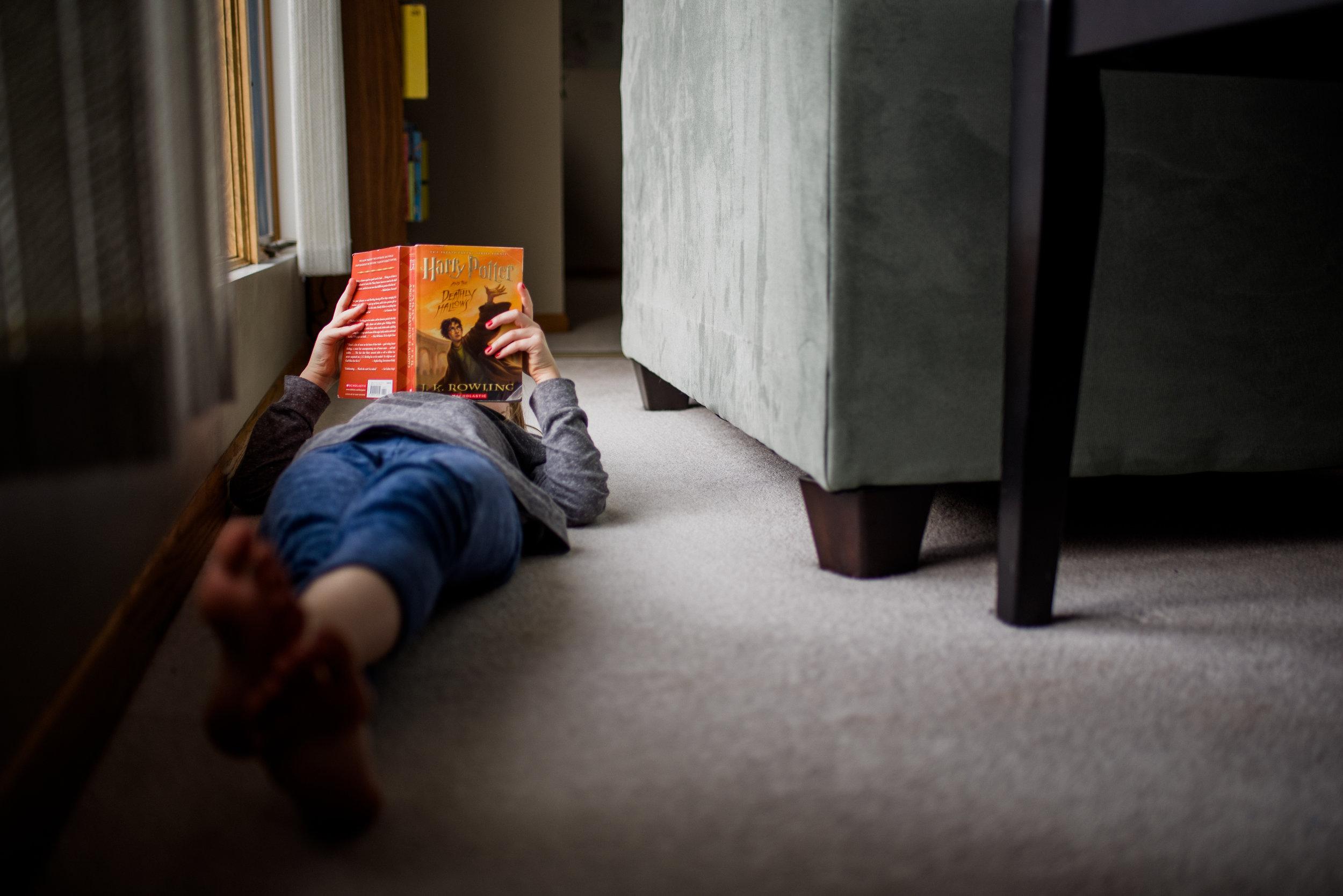 girl reading Harry Potter book.jpg