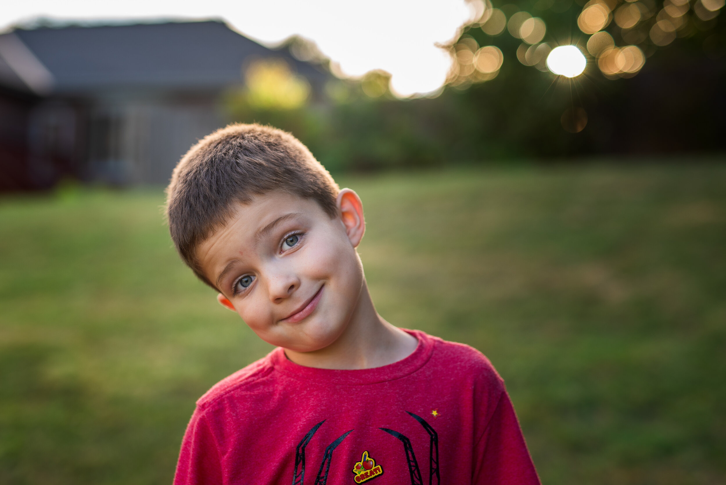 Portrait of a little boy with funny expression outdoors.