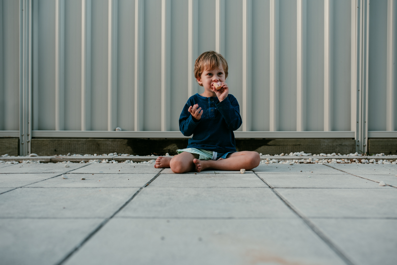 How to get your kid to sit still for a photo 101: give him ALL the ice cream. In this image, I used leading lines to draw the eye in toward my cute little subject, and add some visual interest.