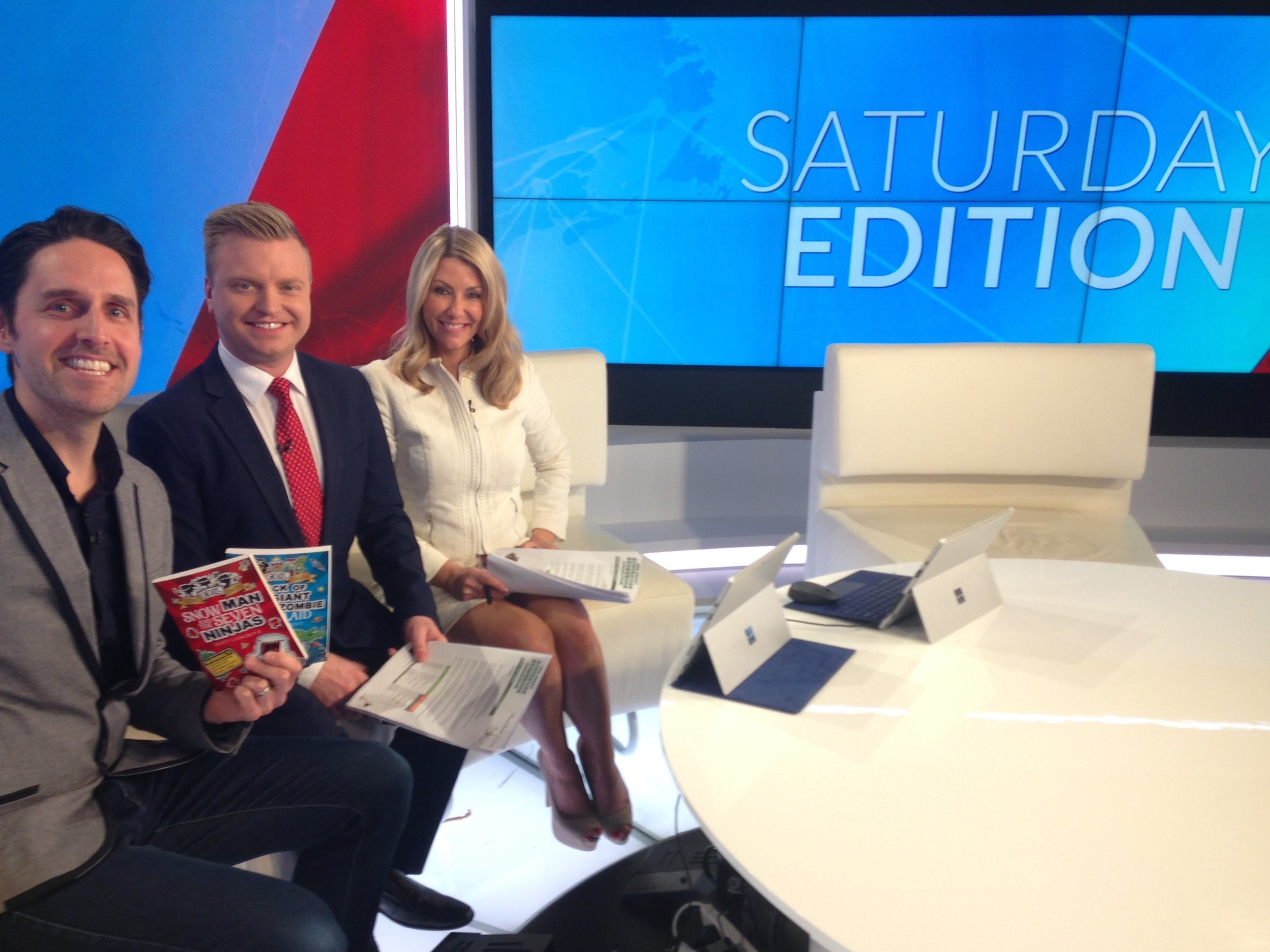 Author and Illustrator, Matt Cosgrove, on the set of SkyNews Saturday Edition with Greg Thomson and Jaynie Seal.