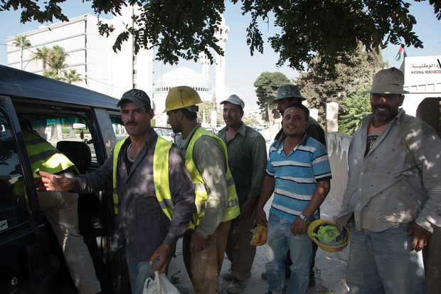 Egyptian construction workers to head home after a long working day in Abdoun, Amman. Photo:Jihad Abaza