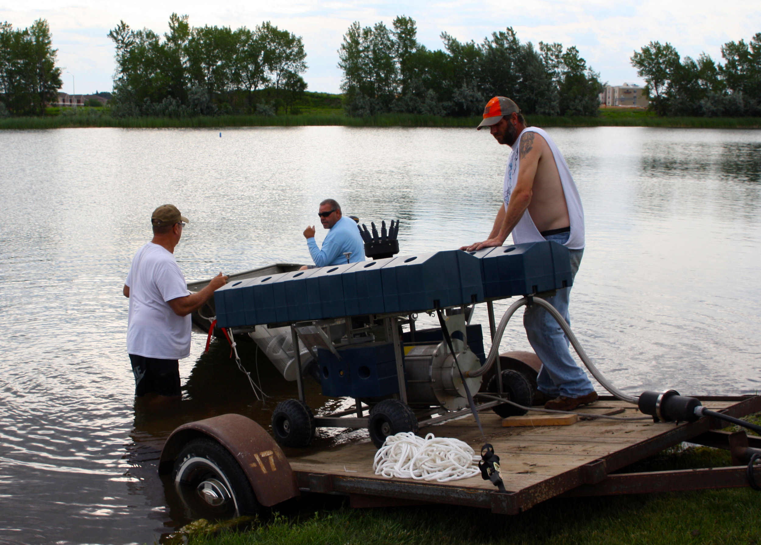 Friessen Construction employees load the fountain into Lake Lorraine.