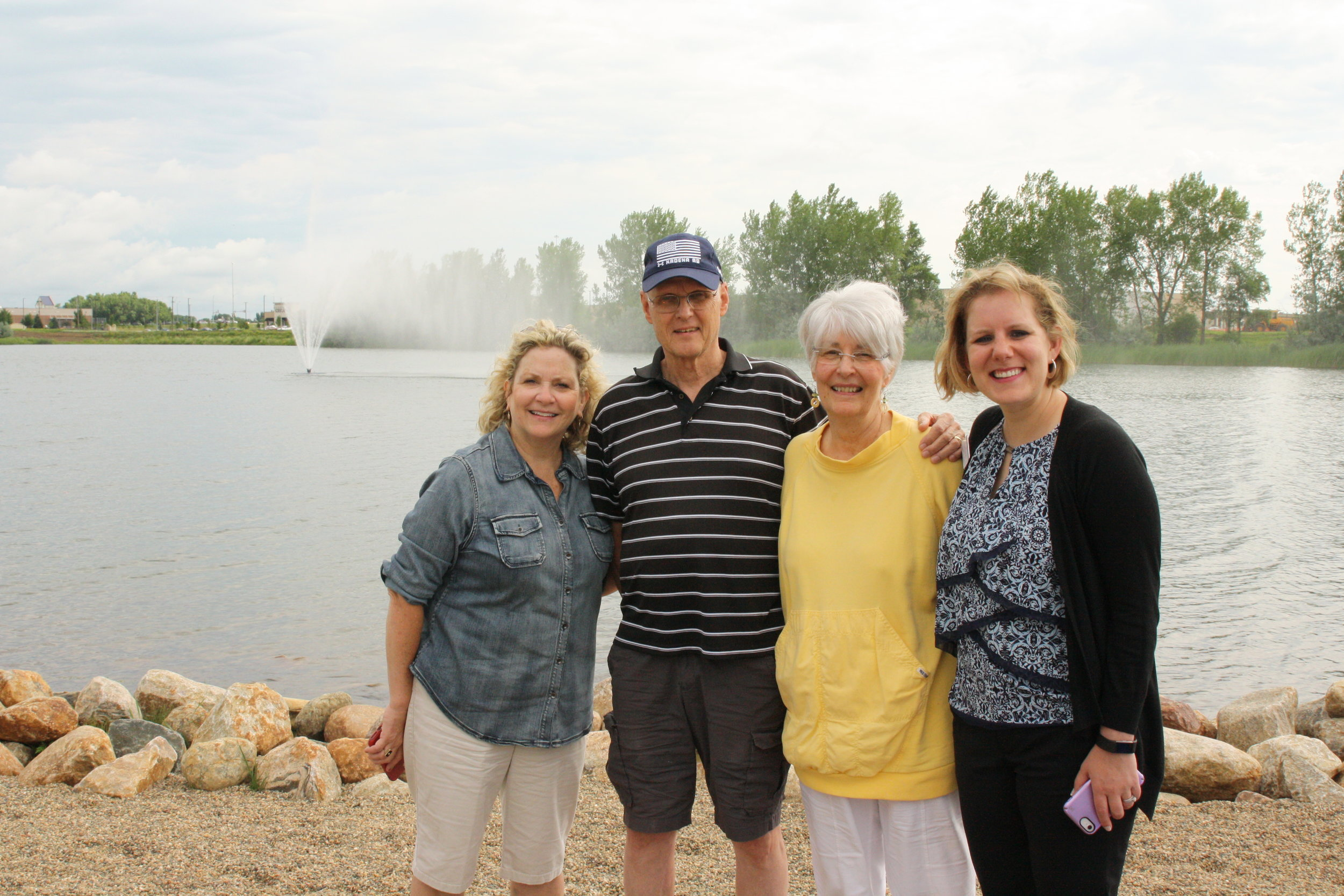 Pictured are some of the residents and staff of Grand Living at Lake Lorraine, who watched the fountain installation from the shore.